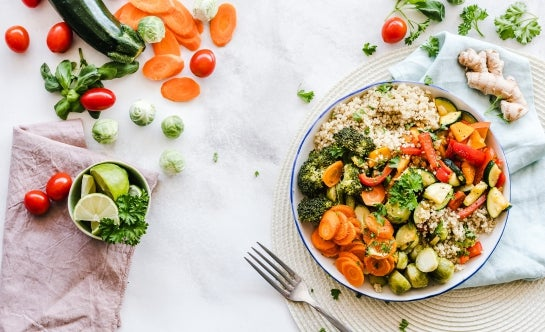 Vegetable and quinoa bowl on white linens