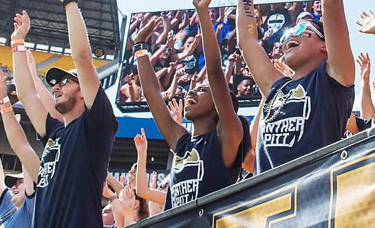 Students cheering on Pitt football on game day