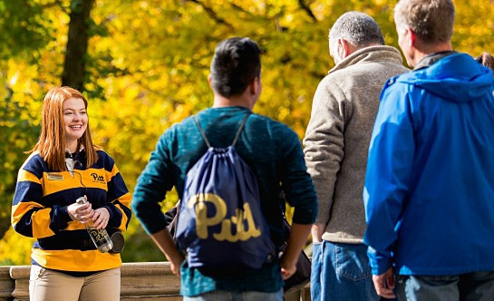 Pitt Pathfinder student tour guide giving a tour of campus