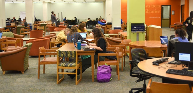 Students at tables in Hillman library